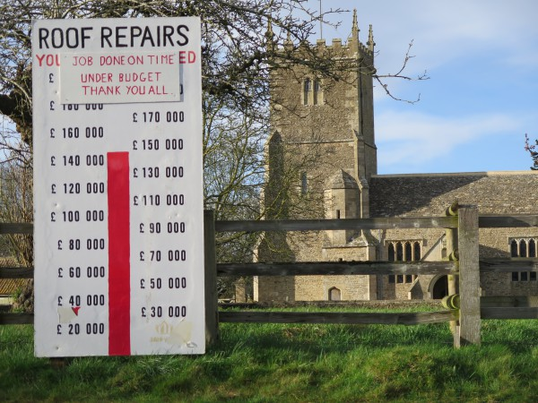 17- roof repair Fund thermometer sign outside the church